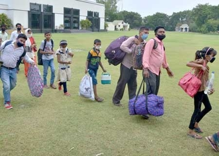 <p>Amritsar: Migrants gather in queues to board buses to reach the Amristar Railway Station to return back to their respective home states via Shramik Special trains during the fourth…
