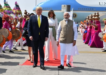 <p>Ahmedabad: Prime Minister Narendra Modi receives US President Donald Trump and First Lady Melania Trump on their arrival at the Sardar Vallabhbhai Patel International Airport in…